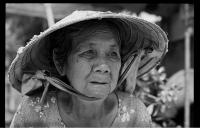 Vietnamese market trader . (Click outside the image to close it).
